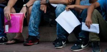 Agentes hallan a 133 migrantes en casa de seguridad en Puebla